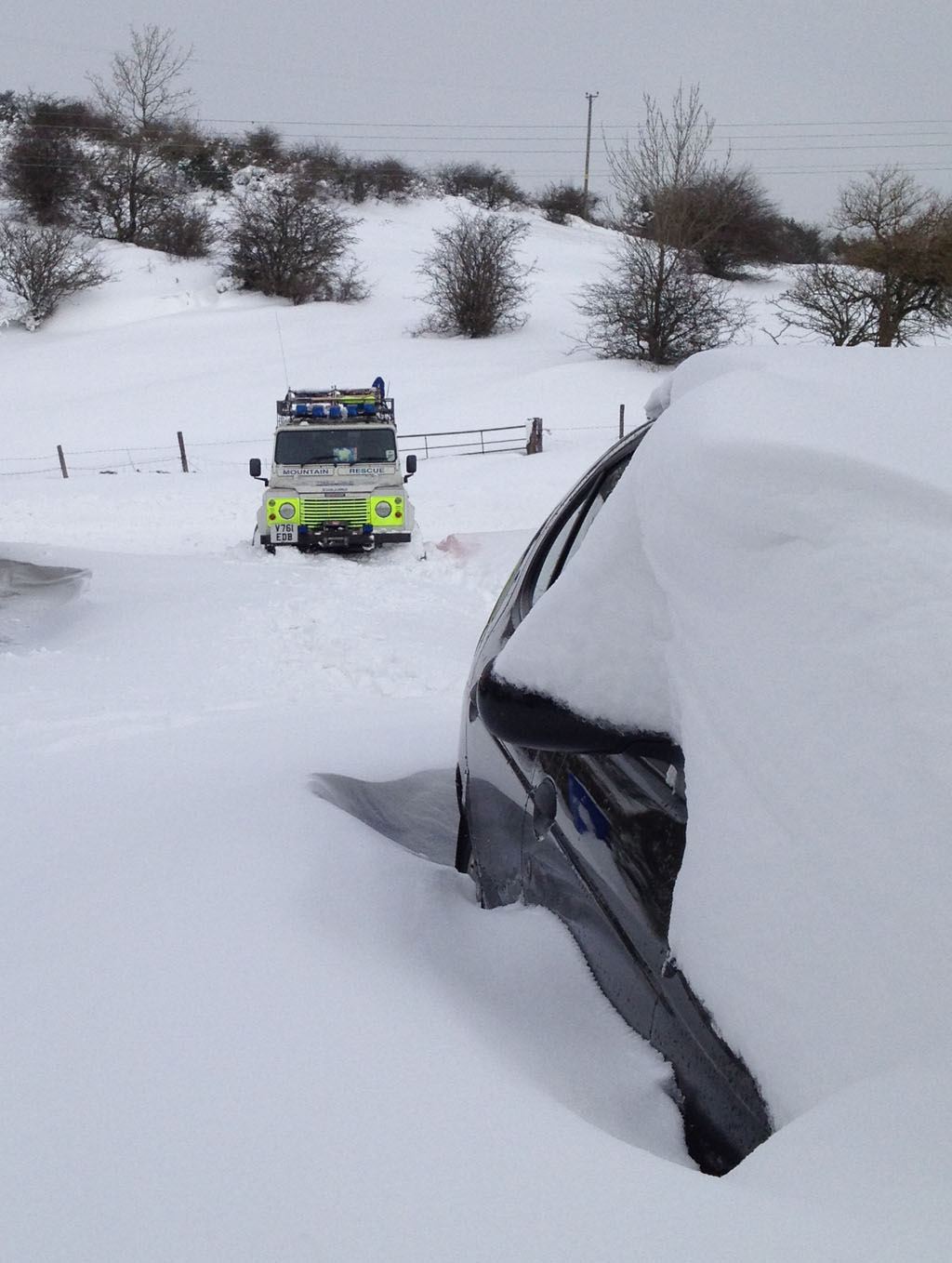 SAR Landrover in deep snow